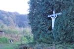 Jesus on a crucifix, in a hedge